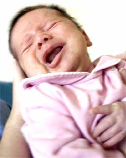 In some cases, babies who will later be diagnosed with Autism display hyersensitivity, and stiffen when hugged or cuddled. This contact is unpleasant due to sensory overload.
